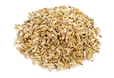 fennel seed: Heap of dried organic fennel seeds on white background Stock Photo