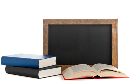 Empty clean old chalkboard with books on white background photo
