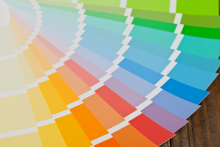 Color chart guide on wooden surface photo
