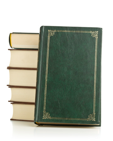 Old leather hardcover books stacked on white background