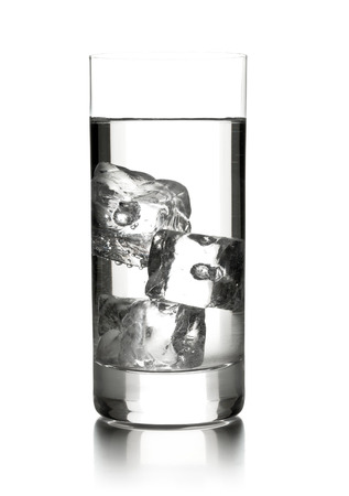 Glass of water with three ice cubes over white background photo