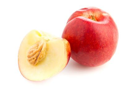 half cut: Whole and half cut white nectarine on white background