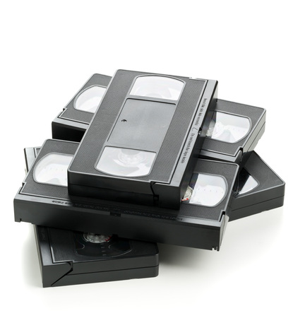 video cassette tape: Heap of analog video home system (VHS) tape over white background