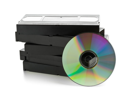 tapes: Analog video cassettes with DVD disc - old movies backup or transfer concept
