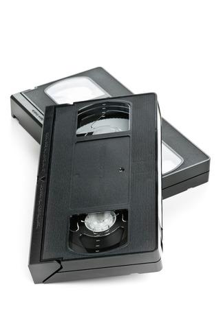 videocassette: Dos sistema de home video analógico (VHS) cinta sobre fondo blanco Foto de archivo