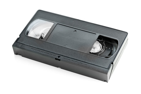 videocassette: Analog video home system (VHS) tape over white background