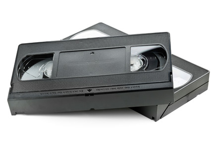 video cassette tape: Two analog video home system (VHS) tape over white background