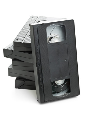 vhs videotape: Stack of analog video home system (VHS) tape over white background