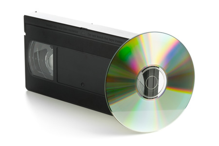 video cassette tape: Analog video cassette with DVD disc - old movies backup or transfer concept