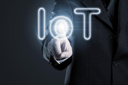 Man touching IoT (internet of things) text on display