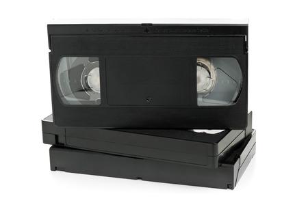 videocassette: Pila de sistema analógico home video (VHS) cinta sobre fondo blanco