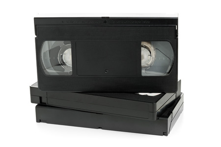 video cassette tape: Stack of analog video home system (VHS) tape over white background