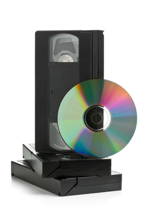 video cassette tape: Analog video cassettes with DVD disc - old movies backup or transfer concept