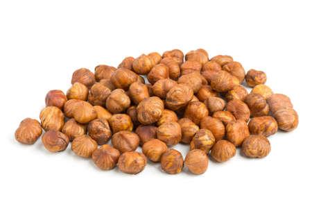 shelled: Pile of cracked and shelled hazelnut kernels on white background