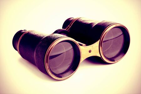 tarnished: Vintage retro binoculars over white background