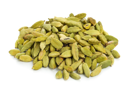 Heap of cardamom seed pods over white background