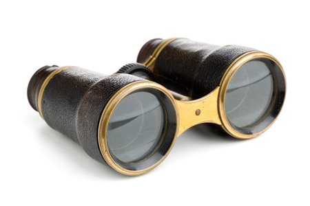 antique binoculars: Vintage retro binoculars over white background