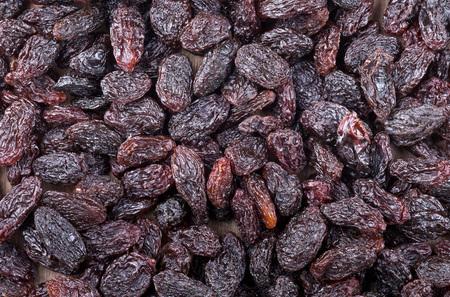 Heap of raisins frame filling background