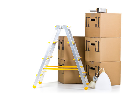 on the move: Ladder with stack of moving carton boxes over white background