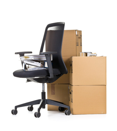 moving office: Office folder on office chair in front of moving boxes over white background - office moving or relocation concept