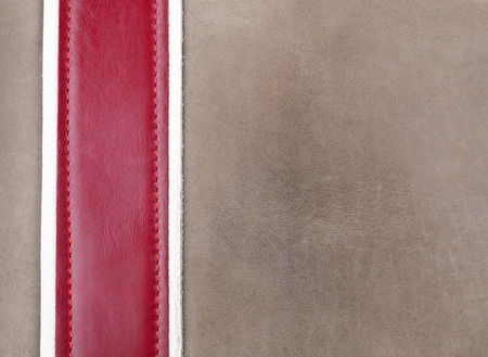 sew tags: Grey and red leather stitched with copy space Stock Photo