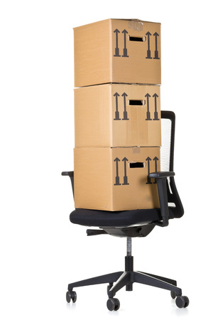 moving office: Moving boxes on  office chair over white background - office moving or relocation concept Stock Photo
