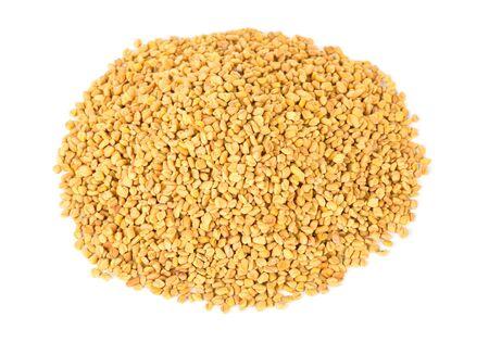unprocessed: Unprocessed whole fenugreek (Trigonella foenum-graecumcumin) seeds heap over white background