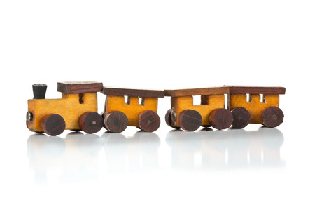 wooden toy: Old, used wooden toy train with locomotive and wagons over white background Stock Photo