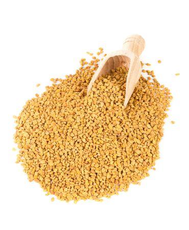 unprocessed: Unprocessed whole fenugreek (Trigonella foenum-graecumcumin) seeds in wooden scoop over white background