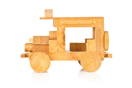 wooden toy: Hand made wooden toy car over white background