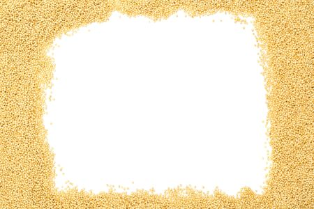 Raw, uncooked amaranth seeds frame on white background with copy space