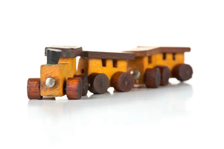 wagons: Old, used wooden toy train with locomotive and wagons over white background Stock Photo