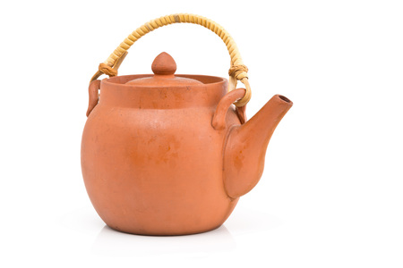 Unglazed brown ceramic tea pot over white background