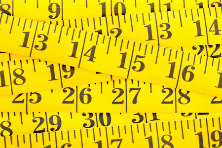 centimetre: Frame filling yellow measurement tape background texture