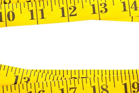 Yellow measurement tape border on white background Stock Photo