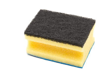 unused: Clean unused yellow cleaning sponge with rubbing pads over white background Stock Photo
