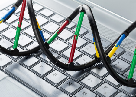 AI: DNA molecule model on computer keyboard. Artificial intelligence concept Stock Photo