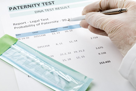 paternity: Paternity DNA test result chart form - doctor pointing at result value