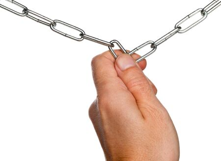 Hand holding together broken ends of two chains isolated on white background