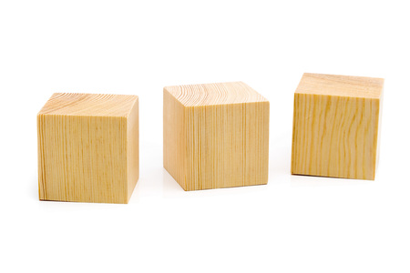 creativeness: Three brown wooden cubes lined up in a row over white background Stock Photo