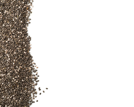 unprocessed: Raw unprocessed whole dried black chia seed border on white background