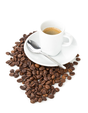 Coffee beans and cup of espresso on white background