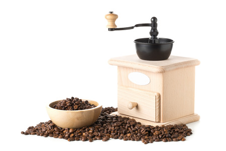 Coffee beans in wooden bowl with wooden coffee bean grinder over white background Stock Photo