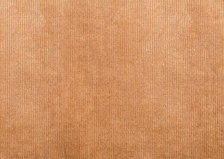 Close up shot of brown worn cord fabric background macro