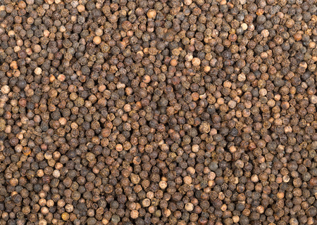 Background of raw, natural, unprocessed black pepper peppercorns