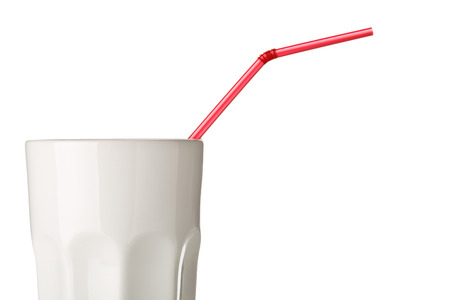 Red straw in white mug side view isolated on white background