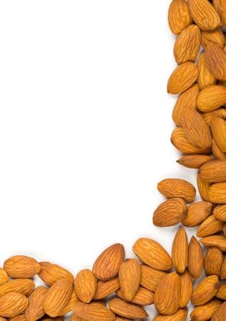 Shelled almond kernels border over white background
