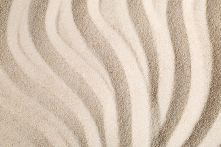 Zen sand garden with raked curved lines. Simplicity, concentration or calmness abstract concept. Top view.