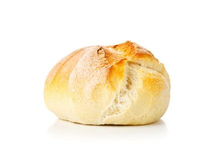 Single, whole, fresh baked wheat bun on white background