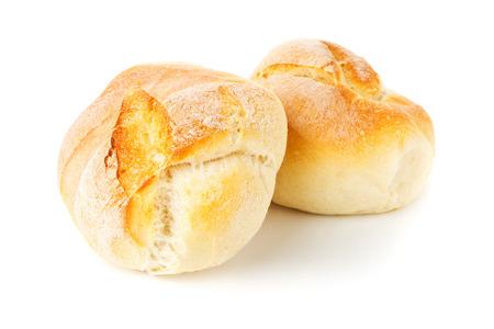 Two whole, fresh baked wheat buns on white background